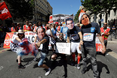 Stock Photo of Protesters wearing the mask of French President Francois Hollande, left, French Prime Minister Manuel Valls and Labor Minister Myriam el Khomry demonstrate in Marseille