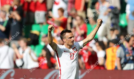 Poland's Slawomir Peszko celebrates at the end of the Euro 2016 round of 16 soccer match between Switzerland and Poland, at the Geoffroy Guichard stadium in Saint-Etienne, France