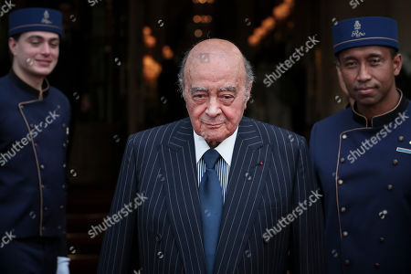 Egyptian businessman and Ritz hotel owner Mohammed Al Fayed poses with his hotel staff in Paris, Monday, June 27, 2016. Ritz owner Mohamed Al-Fayed and officials from Paris City Hall and the French government are inaugurating the newly renovated column at Place Vendome. Al Fayed funded the restoration of the column as a gift to the city, and his hotel recently reopened after years of renovations