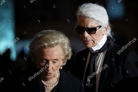 Bernadette Chirac, wife of former French President Jacques Chirac, left, and German fashion designer Karl Lagerfeld arrive at the Ritz Hotel in Paris, Monday, June 27, 2016. Ritz owner Mohamed Al-Fayed and officials from Paris City Hall and the French government are inaugurating the newly renovated column at Place Vendome. Al Fayed funded the restoration of the column as a gift to the city, and his hotel recently reopened after years of renovations
