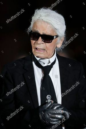 Stock Image of German fashion designer Karl Lagerfeld poses for a photograph, as he arrives at the Ritz Hotel in Paris, Monday, June 27, 2016, as guests arrive for the inauguration of the newly renovated Place Vendome column. Businessman Mohammed Al Fayed funded the restoration.