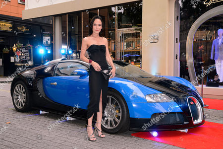 Laurence Bet-Mansour with a Bugatti Veyron