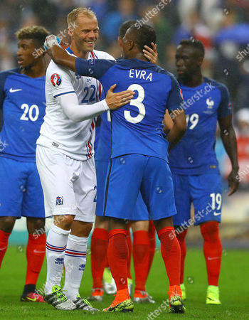 Eidur Gudjohnsen of Iceland embraces Patrice Evra of France at full time during the UEFA Euro 2016 Quarter Final match between France and Iceland played at the Stade de France, Paris, France on July 3rd 2016