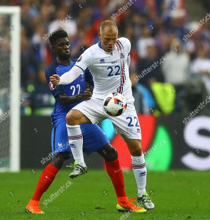 Samuel Umtiti of France and Eidur Gudjohnsen of Iceland in action during the UEFA Euro 2016 Quarter Final match between France and Iceland played at the Stade de France, Paris, France on July 3rd 2016