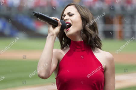 Joanna Pacitti performs the National Anthem prior to the MLB game between the Kansas City Royals and Philadelphia Phillies at Citizens Bank Park in Philadelphia, Pennsylvania. The Philadelphia Phillies won 7-2