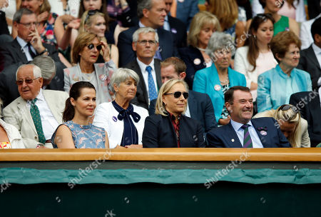 Former tennis star Martina Navratilova, front centre, and her wife Julia Lemigova, front left, sit in the Royal Box
