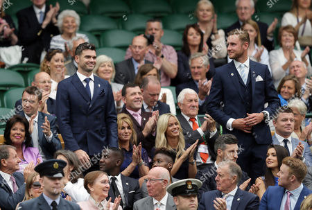 England cricketers James Anderson, left, and Chris Broad receive applause as they sit in the Royal Box