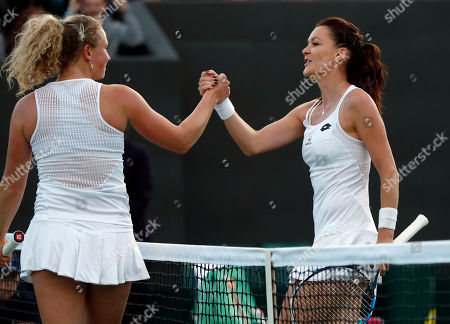 Stock Photo of Agnieszka Radwanska of Poland, right, shakes hands with Katerina Sinakova of the Czech Republic after beating her in their women's singles match