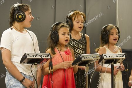 Stock Photo of Natalie Grace Gorsegner and Hannah Rose Gorsegner record the chorus along with other pediatric cancer survivors