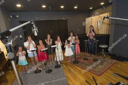 Stock Picture of Taylor Tote records an original song titled 'Fighter' along with Natalie Grace Gorsegner and Hannah Rose Gorsegner