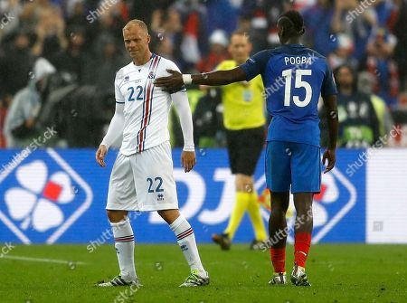 France's Paul Pogba, right, says good-bye to Iceland's Eidur Gudjohnsen after the match