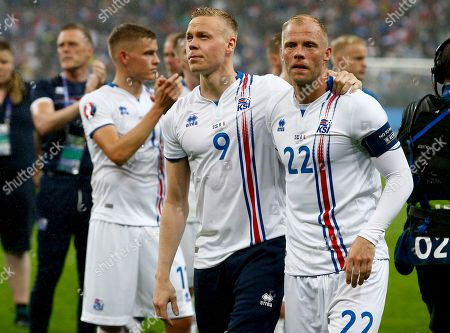 Iceland's Eidur Gudjohnsen, right, and Kolbeinn Sigthorsson salute fans at the end of the match France won 5-2.