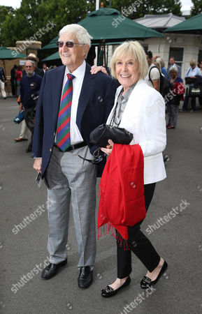 Sir Michael Parkinson and his wife Mary Parkinson arrive during day nine of the 2016 Wimbledon Championships at the All England Lawn Tennis Club, Wimbledon, London on the 5th July 2016