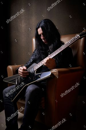 Stock Image of London United Kingdom - June 2: Portrait Of Greek Heavy Metal Musician Kostas Karamitroudis Better Known By His Stage Name Gus G Photographed With His Signature Esp Electric Guitar In London On June 2 2015. Gus Is Best Known As The Lead Guitarist With Ozzy Osbourne And Firewind