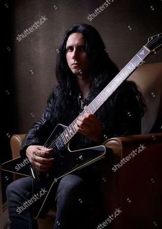 London United Kingdom - June 2: Portrait Of Greek Heavy Metal Musician Kostas Karamitroudis Better Known By His Stage Name Gus G Photographed With His Signature Esp Electric Guitar In London On June 2 2015. Gus Is Best Known As The Lead Guitarist With Ozzy Osbourne And Firewind
