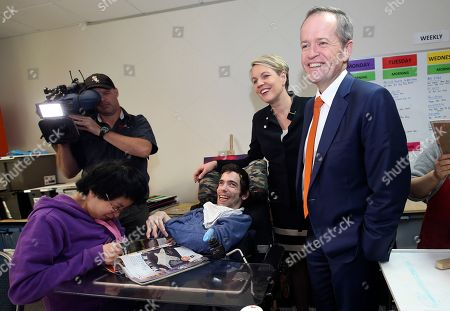 Australia's opposition Labor Party leader Bill Shorten, right, and deputy leader Tanya Plibersek, second right, meet with members of a disability center in Sydney, Friday, July 1, 2016. Shorten is campaigning on the last day before a national election.