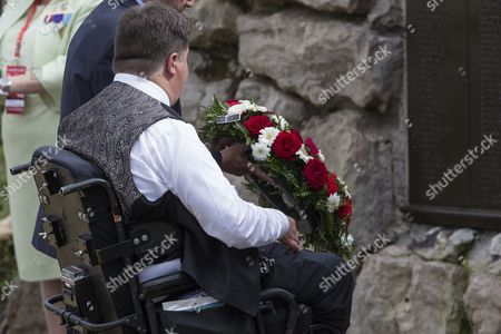 Stock Photo of Canadian Minister of Veterans Affairs, Kent Hehr, lays a wreath of flowers during a memorial ceremony marking the centenary anniversary of the disastrous start to the Somme campaign in the First World War at the Canadian WWI Beaumont-Hamel Newfoundland Memorial in Beaumont Hamel, northern France, Friday, July 1st, 2016. Charles and Camilla were to pay tribute to Northern Irish and Canadian soldiers in two separate events in Thiepval and in the nearby village of Beaumont-Hamel.