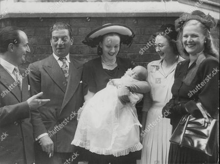 Christening Of Melita Melachrino Daughter Of Band Leader George Melachrino And Actress Sheila Bligh At The Holy Trinity Church Brompton Square. Melita With Parents And Godparents. L-r: George Melachrino Comedian Sid Field Sheila Melachrino Holding Melita Mrs John Bligh And Mrs Laurence Payne. Box 665 729011634 A.jpg.
