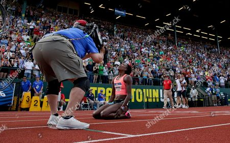 Alysia Montano reacts after falling during the women's 800-meter final at the U.S. Olympic Track and Field Trials