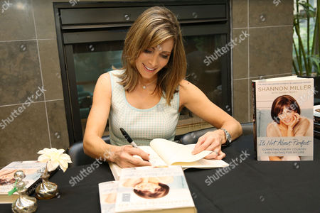"""Shannon Miller signs copies of """"It's Not about Perfect"""" and encourages cancer survivors attending Extended Stay America and the American Cancer Society's 2nd Annual Cancer Survivors Reunion to continue tapping into the gold medal mindset, Tuesday, June 28, 2016 in New York."""