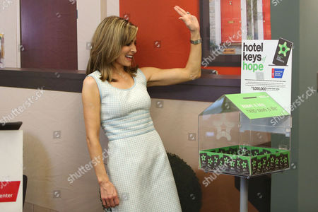 Olympic Gold Medalist Shannon Miller contributes to Extended Stay America's Leave a key. Help save a life.? initiative, Tuesday, June 28, 2016 in New York. For every key left in the lobby's Hotel Keys of Hope? collection box, Extended Stay America donates one dollar of hotel room value, towards the brand's committed total of $1 million dollars to the America Cancer Society.