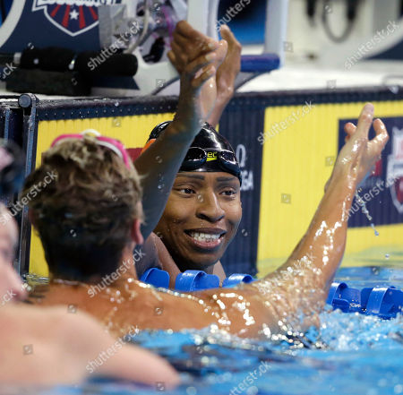 Cullen Jones, right, reacts with Caeleb Dressel, left, after their heat in the men's 50 metre freestyle semifinals.