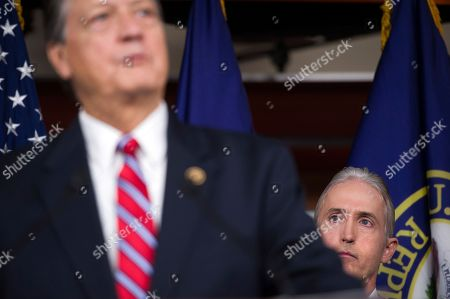 House Benghazi Committee Chairman Rep. Trey Gowdy, R-S.C., listens at right as committee member as committee member Rep. Mike Pompeo, R-Kan., discusses the release of his final report on the 2012 attacks on the U.S. consulate in Benghazi, Libya, where a violent mob killed four Americans, including Ambassador Christopher Stevens, Tuesday, June 28, 2016, during a news conference on Capitol Hill in Washington.