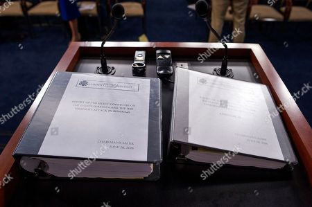 The final report on the 2012 attacks on the U.S. consulate in Benghazi, Libya, where a violent mob killed four Americans, including Ambassador Christopher Stevens, rest on a podium on Capitol Hill in Washington, Tuesday, June 28, 2016. Chairman Gowdy and other Republicans on the panel accuse the Obama administration of stonewalling important documents and witnesses but Democrats say the panel's primary goal is to undermine the presidential candidacy of Hillary Clinton who was secretary of state during the attacks.