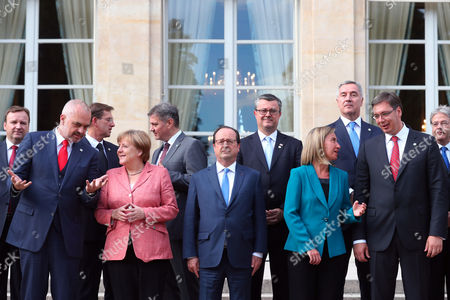 Front row from left: Prime Minister of Albania Edi Rama, German Chancellor Angela Merkel, France's President Francois Hollande, European Union High Representative Federica Mogherini, Prime Minister of Serbia Aleksandar Vucic ; second row left, Prime Minister of Macedonia Emil Dimitriev, fourth from left, Prime Minister of Croatia Tihomir Oreskovic and second from right, Prime Minister of Montenegro Milo Dukanovic pose for a photo during the Balkans summit
