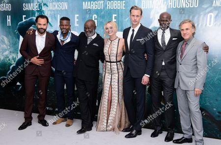 Casper Crump, guest, Djimon Hounsou, Margot Robbie, Alexander Skarsgård, Yule Masiteng and Christoph Waltz