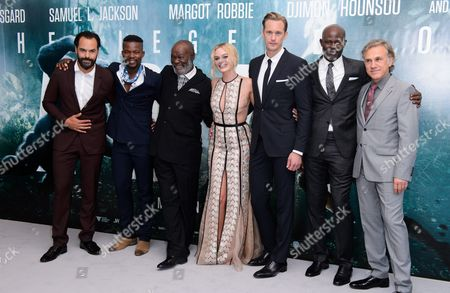 Stock Photo of Casper Crump, guest, Djimon Hounsou, Margot Robbie, Alexander Skarsgård, Yule Masiteng and Christoph Waltz