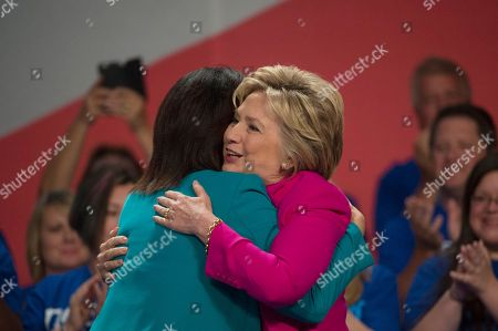 Democratic presidential candidate Hillary Clinton hugs NEA President Lily Eskelsen Garcia before addressing the The National Education Association (NEA) Representative Assembly in Washington, Tuesday, July 5, 2016.