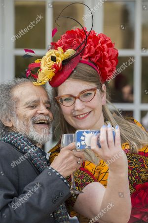 Stock Image of Sarah McIntyre, author, takes a selfie with John Agard, one of the judges