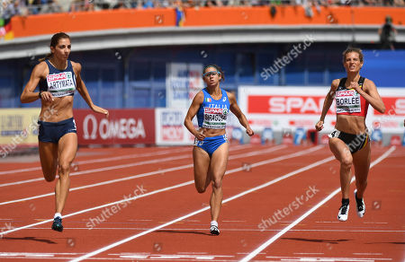 Cyprus' Eleni Artymata, Italy's Irene Siragusa and Belgium's Olivia Borlee, from left, compete in a women's 200m qualification heat