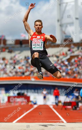 Germany's Fabian Heinle makes an attempt in the men's long jump qualification
