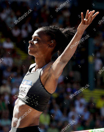 Chaunte Lowe reacts after clearing the bar during qualifying for the women's high jump event