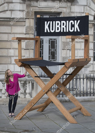 A Somerset House staff member looks up at an oversized directors chair by American artist Nancy Fouts, part of the exhibition Daydreaming with Stanley Kubrick in partnership with Canon at Somerset House in London. The show opens on July 6, 2016 and runs until August 24, 2016