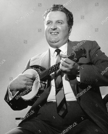 Bill Logan Leads The Members Of The 'george Formby Society' In A Ukelele Sing Song. Logan A Carlisle Company Chairman Is The President Of The Society. Box 667 609021640 A.jpg.