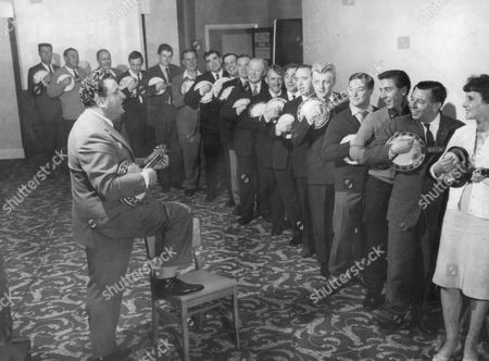 Bill Logan Leads The Members Of The 'george Formby Society' In A Ukelele Sing Song. Logan A Carlisle Company Chairman Is The President Of The Society. Box 667 60902164 A.jpg.