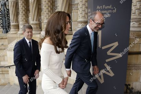 Catherine Duchess of Cambridge walks with Stephen Deuchar, right, the director of the Art Fund and Michael Dixon the Director of the Natural History Museum as she arrives ahead of presenting the Art Fund Museum of the Year 2016 prize at a dinner hosted at the Natural History Museum in London, Wednesday, July 6, 2016. The Art Fund Museum of the Year prize is awarded annually to one outstanding museum which has shown exceptional imagination, innovation and achievement in the preceding year.