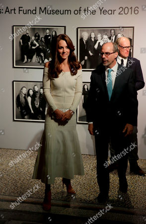 Catherine Duchess of Cambridge walks with Stephen Deuchar the director of the Art Fund backdropped by Rankin photographs ahead of presenting the Art Fund Museum of the Year 2016 prize at a dinner hosted at the Natural History Museum in London, Wednesday, July 6, 2016. The Art Fund Museum of the Year prize is awarded annually to one outstanding museum which has shown exceptional imagination, innovation and achievement in the preceding year.