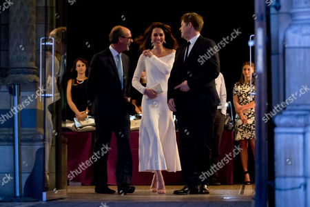 Catherine Duchess of Cambridge talks to Michael Dixon, right, the Director of the Natural History Museum and Stephen Deuchar, left, the director of the Art Fund as she leaves after announcing the Victoria and Albert Museum as the winner of the Art Fund Museum of the Year 2016 prize, at the Natural History Museum in London, Wednesday, July 6, 2016. The Art Fund Museum of the Year prize is awarded annually to one outstanding museum which has shown exceptional imagination, innovation and achievement in the preceding year.