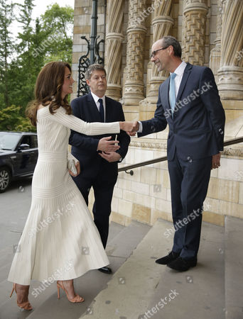 Catherine Duchess of Cambridge is greeted by Sir Michael Dixon, left, the Director of the Natural History Museum and Stephen Deuchar, right, the director of the Art Fund as she arrives to present the Art Fund Museum of the Year 2016 prize at a dinner hosted at the Natural History Museum in London, Wednesday, July 6, 2016. The Art Fund Museum of the Year prize is awarded annually to one outstanding museum which has shown exceptional imagination, innovation and achievement in the preceding year.