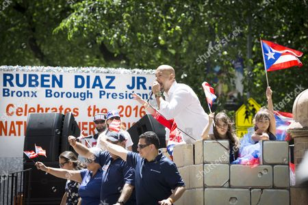 Ruben Diaz Jr, Bronx Borough President rides on a float during the 59th annual National Puerto Rican Day Parade on 5th Avenue