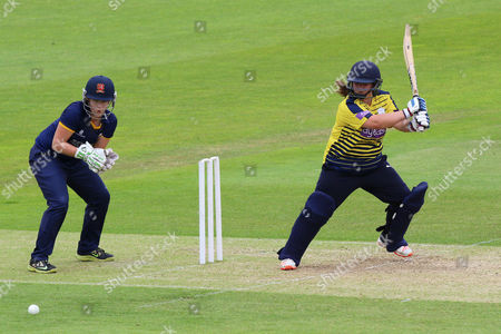 Charlotte Taylor in batting action for Hampshire as Emily Smith looks on from behind the stumps during Hampshire Women vs Essex Women, NatWest Women's County T20 Cricket at the Ageas Bowl on 8th July 2016