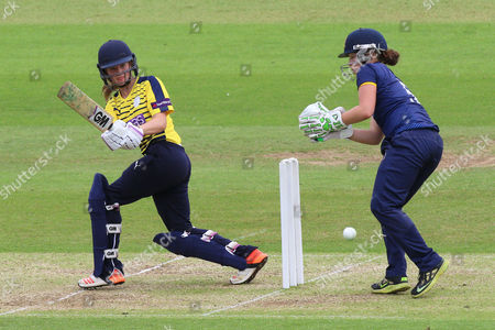 Emily Windsor in batting action for Hampshire as Emily Smith looks on from behind the stumps during Hampshire Women vs Essex Women, NatWest Women's County T20 Cricket at the Ageas Bowl on 8th July 2016