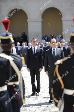 French president Francois Hollande and French Prime Minister Manuel Valls during a solemn and national tribute ceremony for Former Prime Minister Michel Rocard at the Hotel des Invalides in Paris