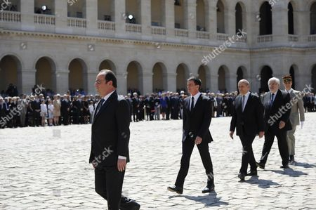 French president Francois Hollande, French Prime Minister Manuel Valls, Defense Minister Jean-Yves Le Drian during a solemn and national tribute ceremony for Former Prime Minister Michel Rocard at the Hotel des Invalides in Paris