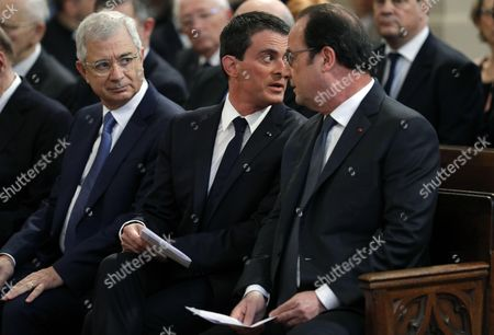 French President Francois Hollande (R), Prime Minister Manuel Valls (C) and French National Assembly speaker Claude Bartolone