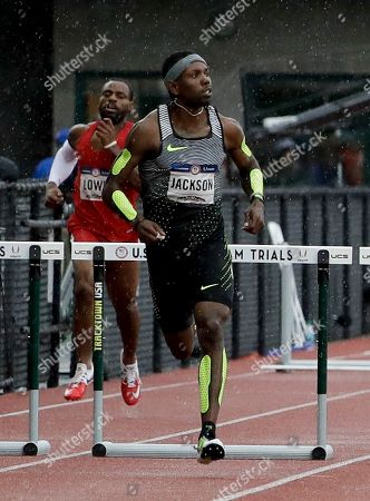 Bershawn Jackson runs during his heat in the men's 400 metres hurdles